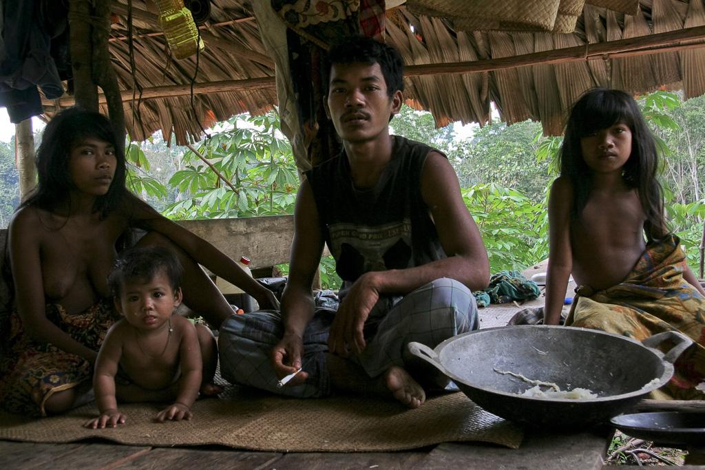 Orang Rimba family at their hut. Jungle Area of Bukit Duabelas National Park. Jambi province. Sumatra. Indonesia.
