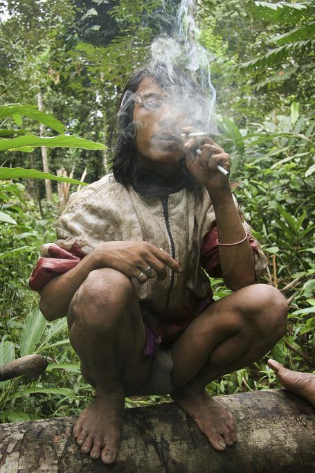 Orang rimba boy smoking. Jungle Area of Bukit Duabelas National Park. Jambi province. Sumatra. Indonesia.