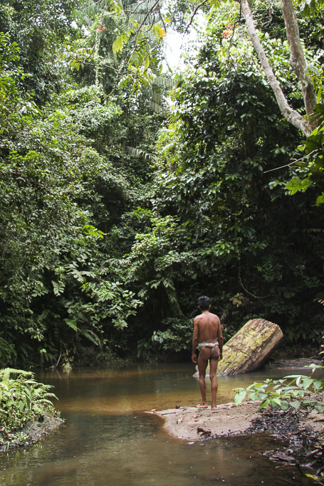Orang rimba man in a stream of the jungle. Jungle Area of Bukit Duabelas National Park. Jambi province. Sumatra. Indonesia.