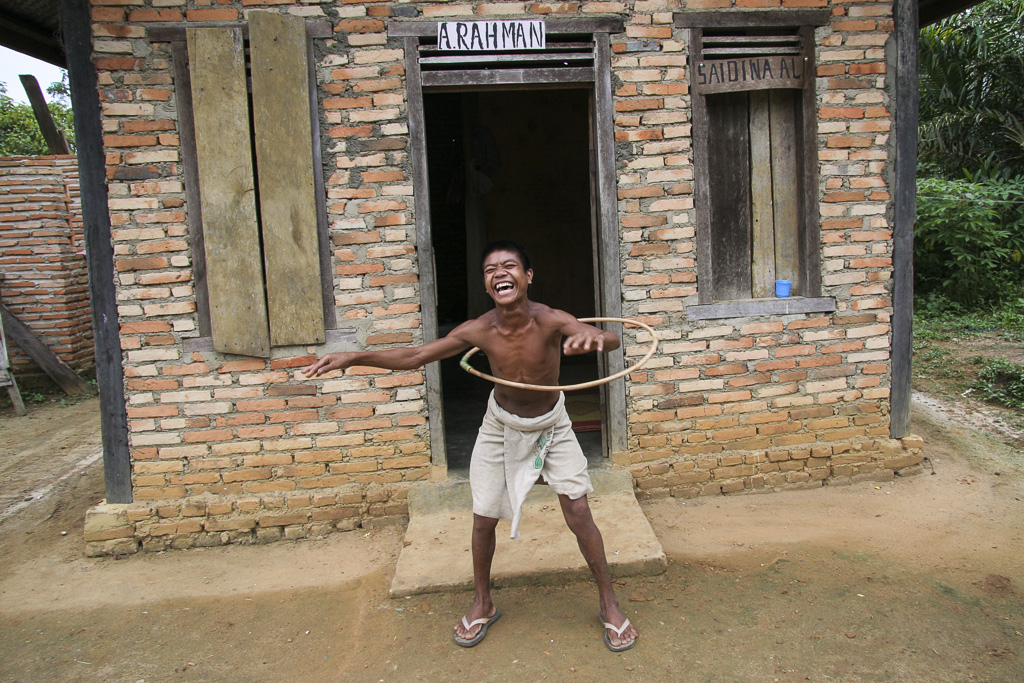 """A joyous young guy from the """"Orang Rimba"""" tribe. Some members of this tribe have established settlements next to  the villages of common inhabitants of Sumatra, converting to Islam, tired of a hard life in the jungle, shamed by other ethnic groups who are"""