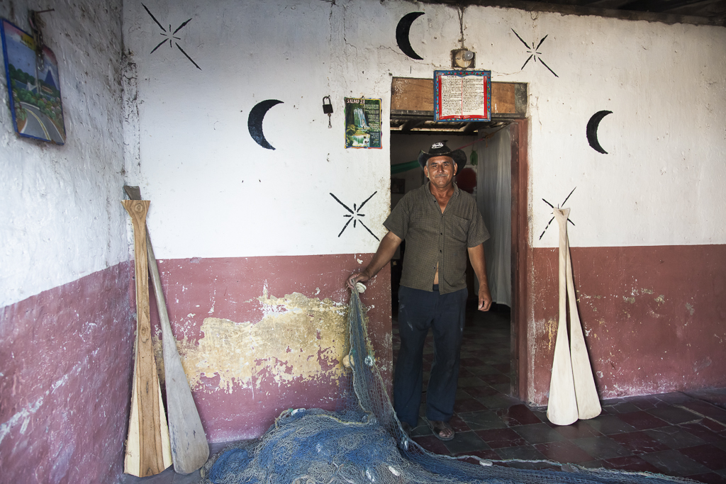 Don Vicente Santos Robles, Fisherman, at his house´s door where he manufactures paddles.