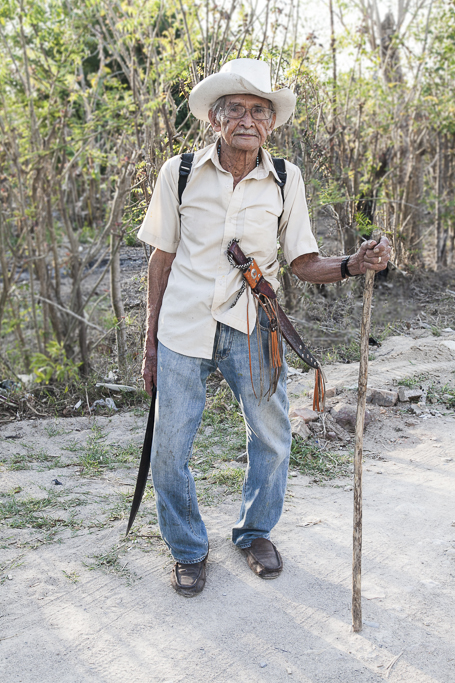An old man come back home after a hard day in the orchard. El Paraiso. Chalatenango. El Salvador