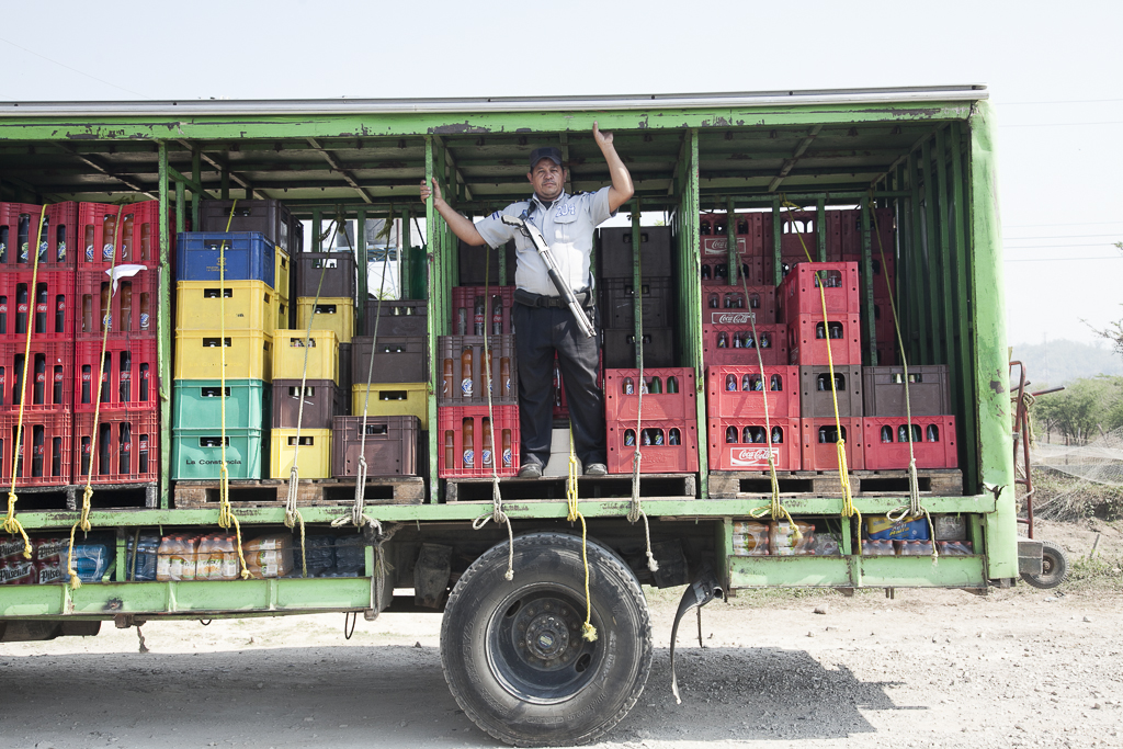 The beverages truck is always scorted by a guard during the delivery. El Paraiso. Chalatenango. El Salvador