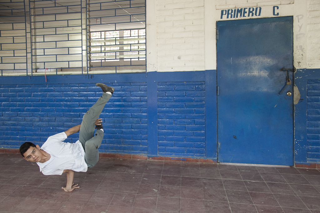 A teenager showing his skills for break dance in the Institute of