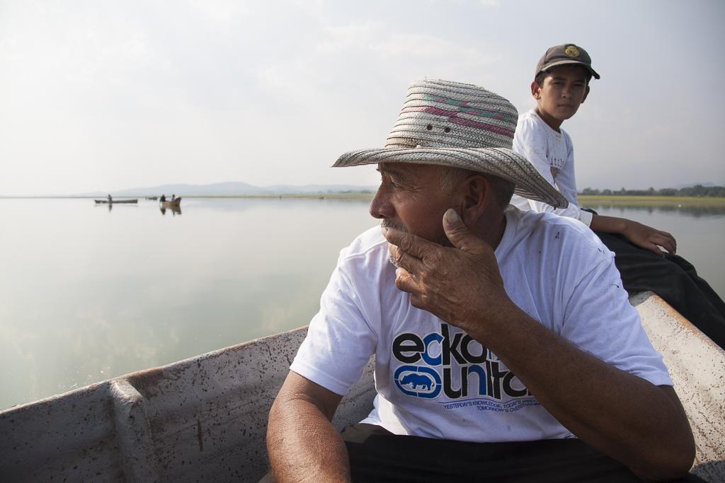 Santos Wenceslao Gutiérrez Castro, fisherman, looks the horizon with concern. Presently, Fishermen communities of the Cerron Grande reservoir must face pollution and invasive flora and fauna. Cerron Grande wetlands. Chalatenango. El Salvador.