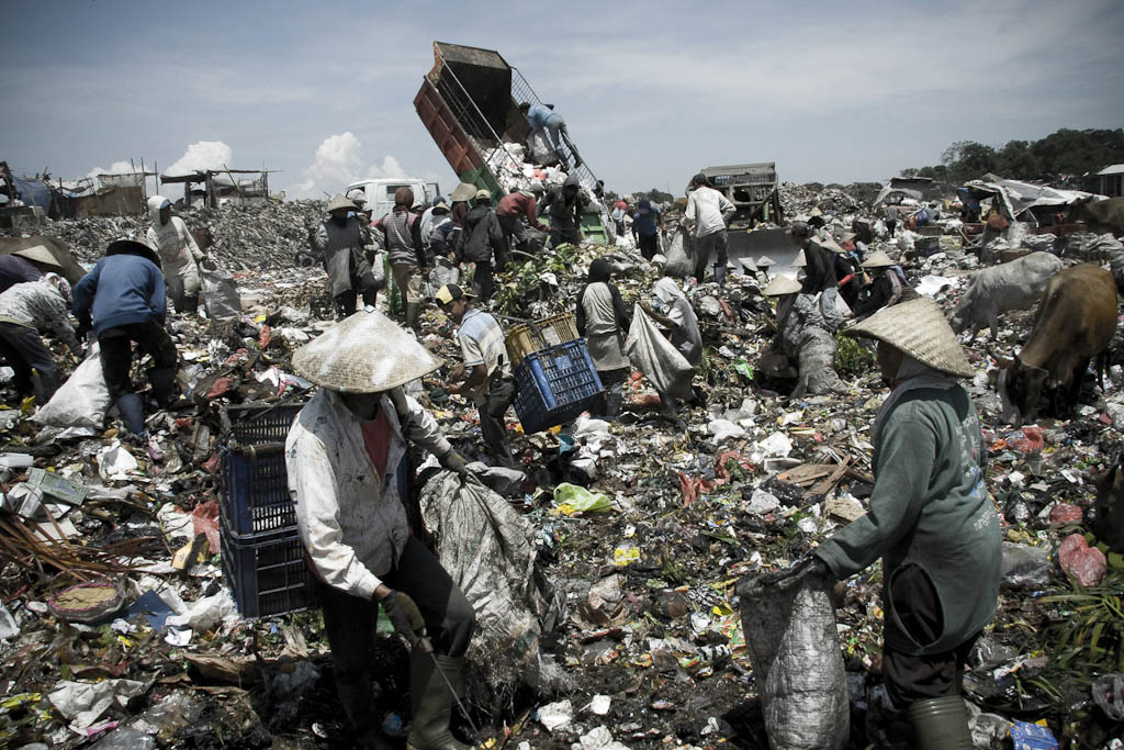 Intrepid heroes of recycling fighting for survive. Makkasar dump. Indonesia.