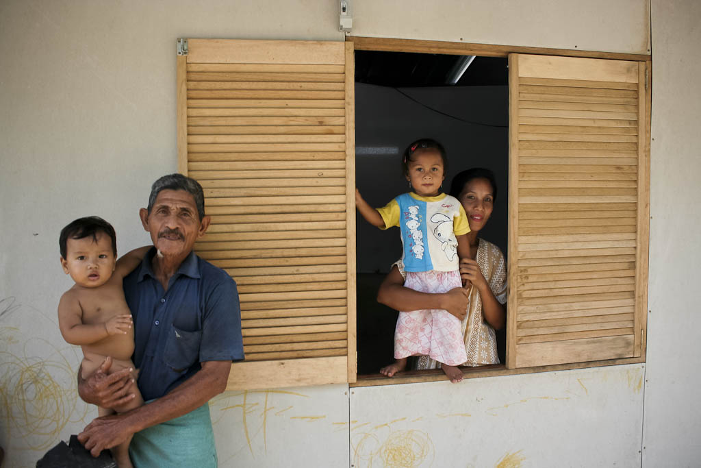 Grandparents take care of kids in their temporary house build with asbestos panels, a point of controversy in the tsunami international aid due to this material is related to cancer. One year after 2004 December 26 tsunami reportage. Banda Aceh, Aceh province, Sumatra, Indonesia.